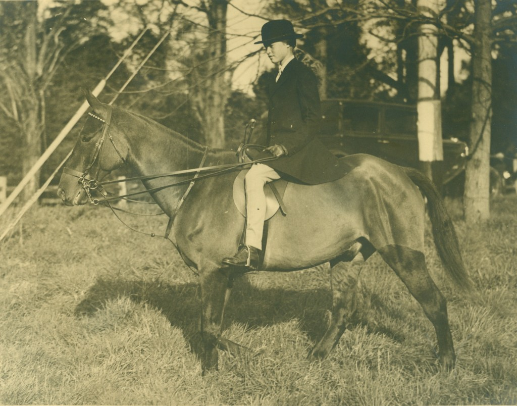 Mary, as a young girl, riding a horse.